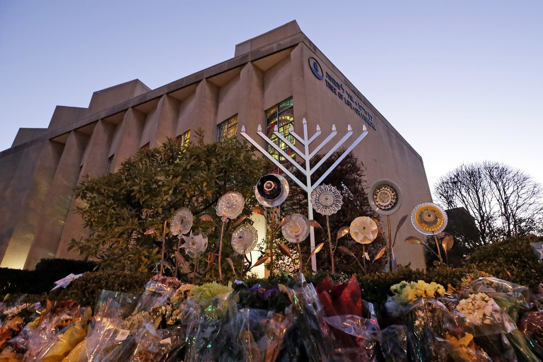 A menorah is installed outside the Tree of Life Synagogue in preparation for a celebration service at sundown on the first night of Hanukkah, Sunday, Dec. 2, 2018 in the Squirrel Hill neighborhood of Pittsburgh. A gunman shot and killed 11 people while they worshipped Saturday, Oct. 27, 2018 at the temple. (AP Photo/Gene J. Puskar)