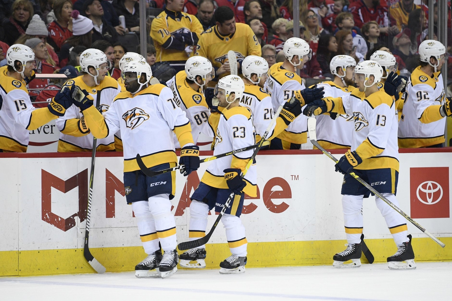 Nashville Predators center Rocco Grimaldi (23) celebrates his goal with the bench and defenseman P.K. Subban (76) and center Nick Bonino (13) during the first period of an NHL hockey game against the Washington Capitals, Monday, Dec. 31, 2018, in Washington. (AP Photo/Nick Wass)