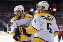 Nashville Predators center Frederick Gaudreau, left, celebrates his goal with defenseman Dan Hamhuis (5) during the second period of an NHL hockey game against the Washington Capitals, Monday, Dec. 31, 2018, in Washington. (AP Photo/Nick Wass)