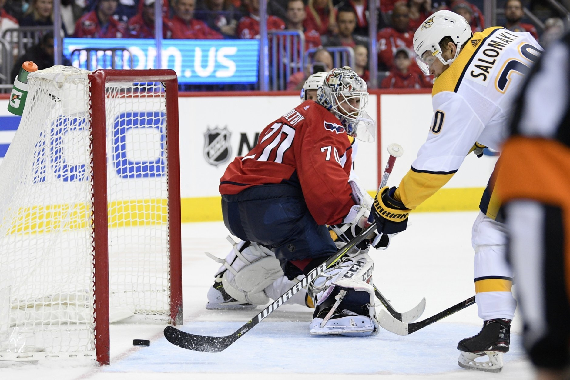 Nashville Predators right wing Miikka Salomaki (20), of Finland, scores a goal against Washington Capitals goaltender Braden Holtby (70) during the second period of an NHL hockey game, Monday, Dec. 31, 2018, in Washington. (AP Photo/Nick Wass)