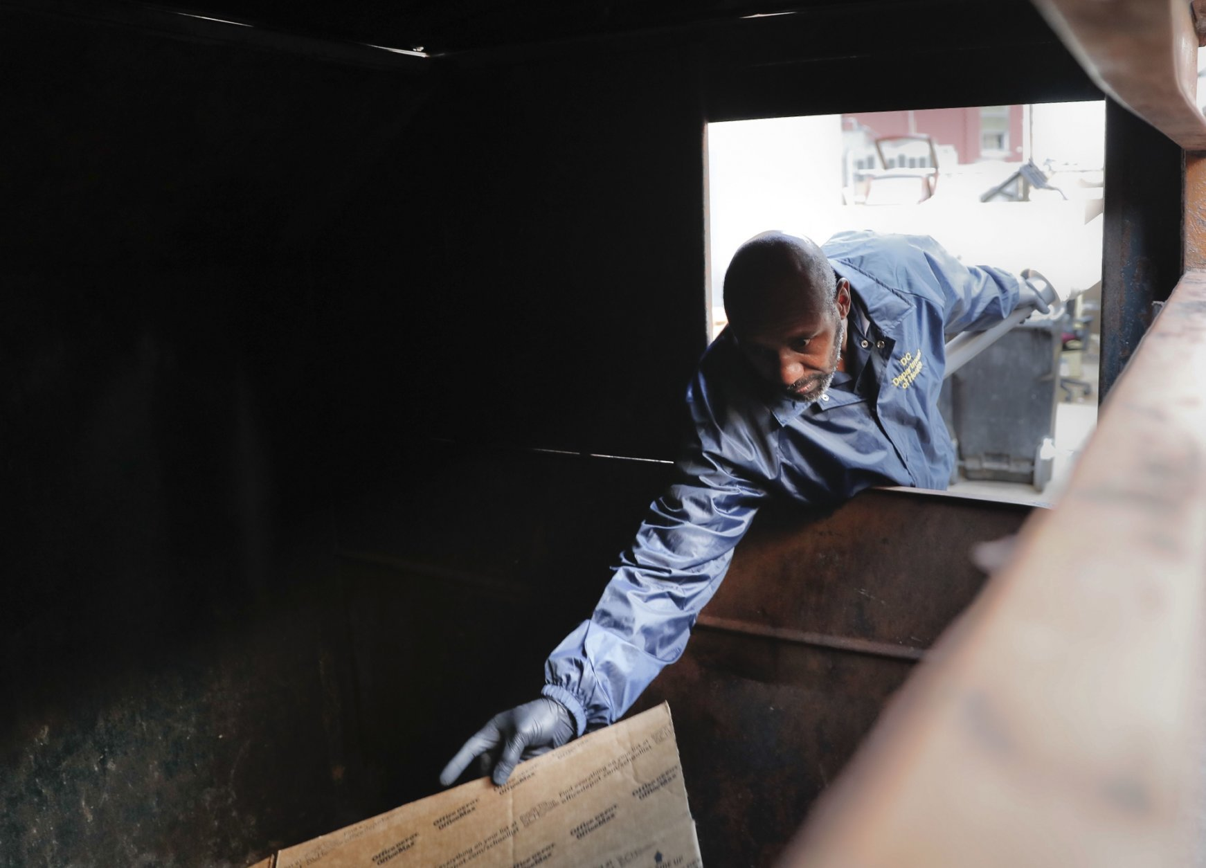 Pest Control Officer Gregory Cornes, from the D.C. Department of Health's Rodent Control Division, inspects a trash dumpster in an alley behind an office building in downtown Washington, Wednesday, Oct. 17, 2019. The nation's capital is facing a spiraling rat infestation, fueled by mild winters and a human population boom. Washington's government is struggling to keep pace (AP Photo/Pablo Martinez Monsivais)