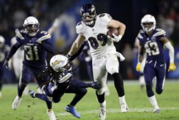 Baltimore Ravens tight end Mark Andrews runs for a touchdown past Los Angeles Chargers strong safety Jahleel Addae during the second half in an NFL football game Saturday, Dec. 22, 2018, in Carson, Calif. (AP Photo/Marcio Jose Sanchez)