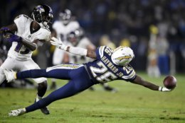 Los Angeles Chargers cornerback Casey Hayward tries to intercept a pass intended for Baltimore Ravens wide receiver John Brown during the second half in an NFL football game Saturday, Dec. 22, 2018, in Carson, Calif. (AP Photo/Kelvin Kuo)