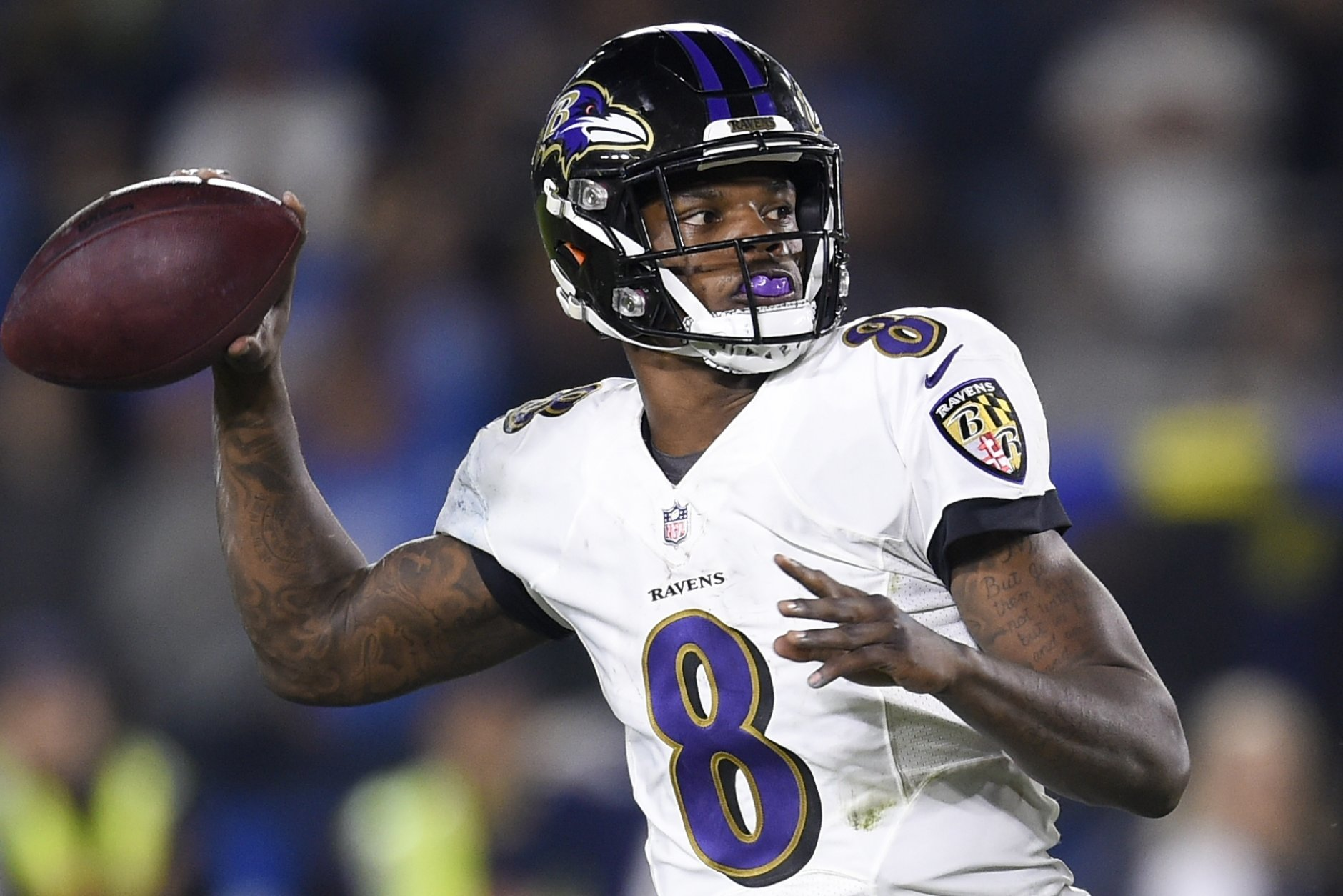 Baltimore Ravens quarterback Lamar Jackson passes against the Los Angeles Chargers during the first half in an NFL football game Saturday, Dec. 22, 2018, in Carson, Calif. (AP Photo/Kelvin Kuo)
