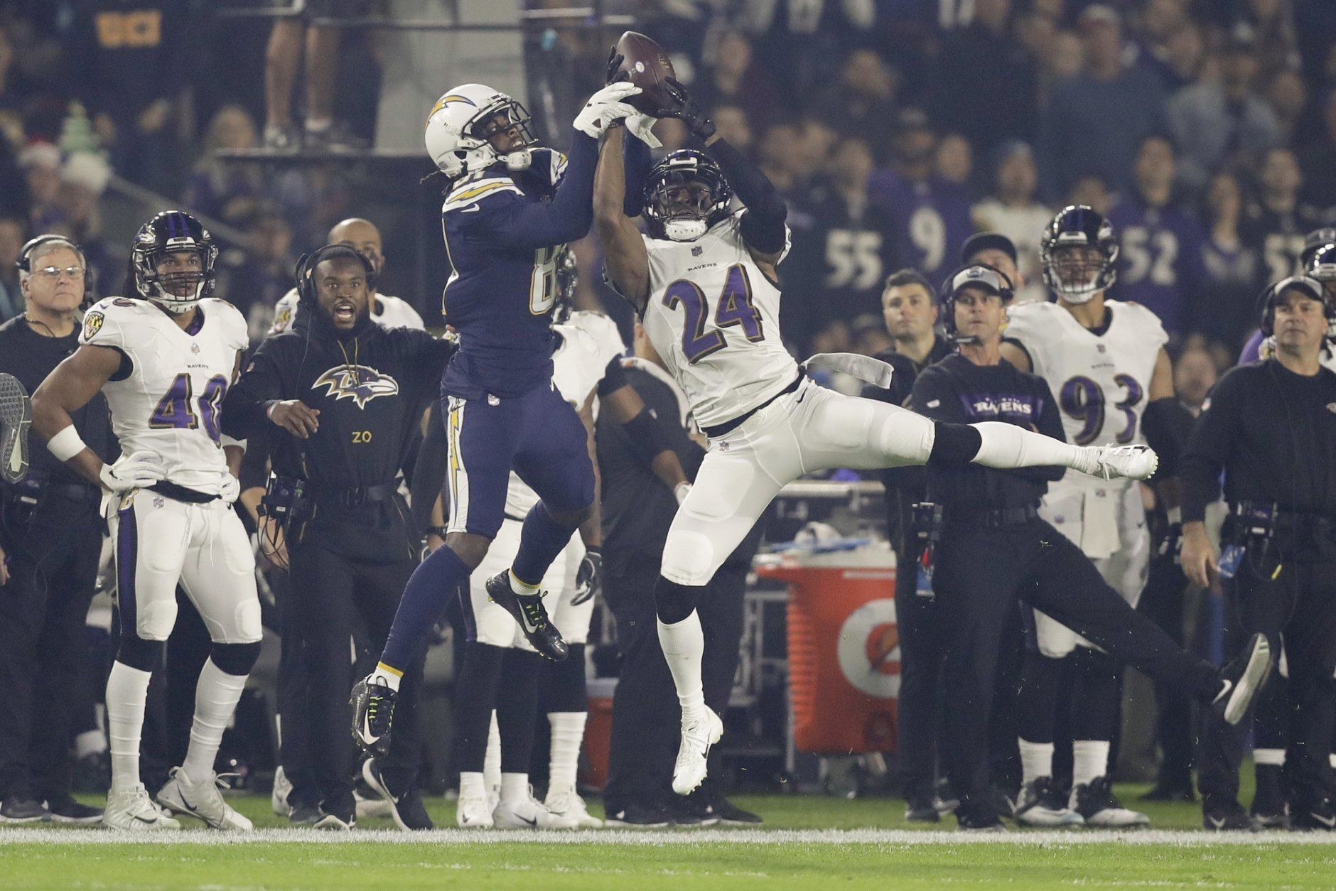 Baltimore Ravens cornerback Brandon Carr intercepts a passes intended for Los Angeles Chargers wide receiver Mike Williams during the first half in an NFL football game Saturday, Dec. 22, 2018, in Carson, Calif. (AP Photo/Marcio Jose Sanchez)