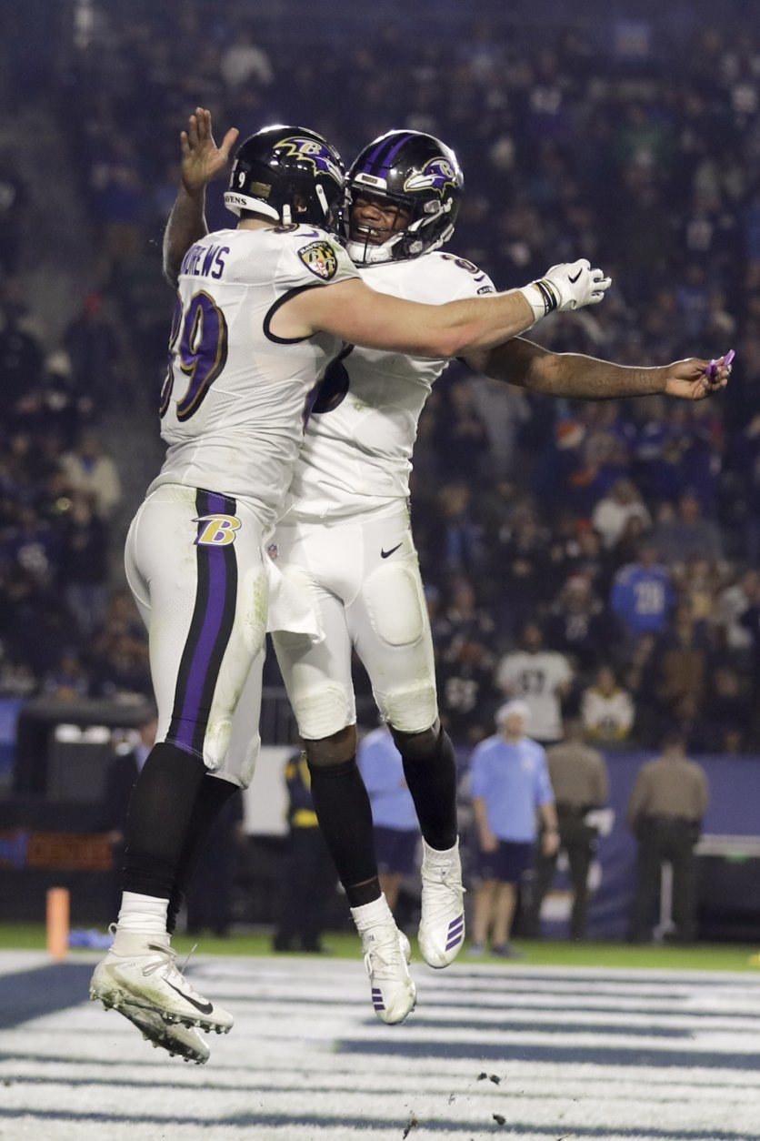 Baltimore Ravens tight end Mark Andrews, left, celebrates after scoring with quarterback Lamar Jackson during the second half in an NFL football game against the Los Angeles Chargers Saturday, Dec. 22, 2018, in Carson, Calif. (AP Photo/Marcio Jose Sanchez)