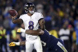 Baltimore Ravens quarterback Lamar Jackson passes under pressure from Los Angeles Chargers defensive tackle Darius Philon during the first half in an NFL football game Saturday, Dec. 22, 2018, in Carson, Calif. (AP Photo/Kelvin Kuo)
