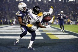 Los Angeles Chargers cornerback Michael Davis breaks up a pass intended for Baltimore Ravens wide receiver Michael Crabtree during the first half in an NFL football game Saturday, Dec. 22, 2018, in Carson, Calif. (AP Photo/Kelvin Kuo)