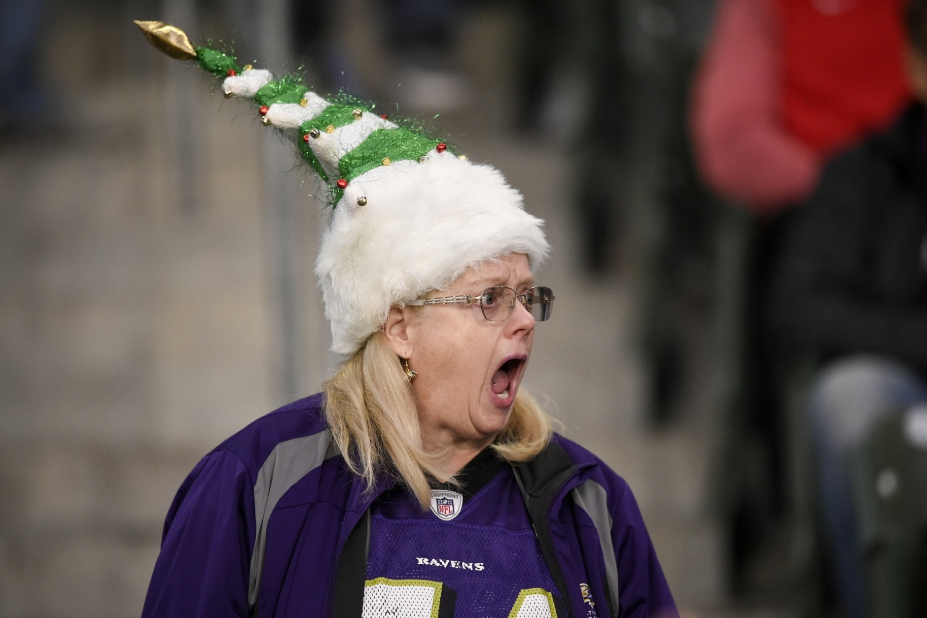 A Baltimore Ravens fan yells during warms ups before an NFL football game against the Los Angeles Chargers Saturday, Dec. 22, 2018, in Carson, Calif. (AP Photo/Kelvin Kuo)