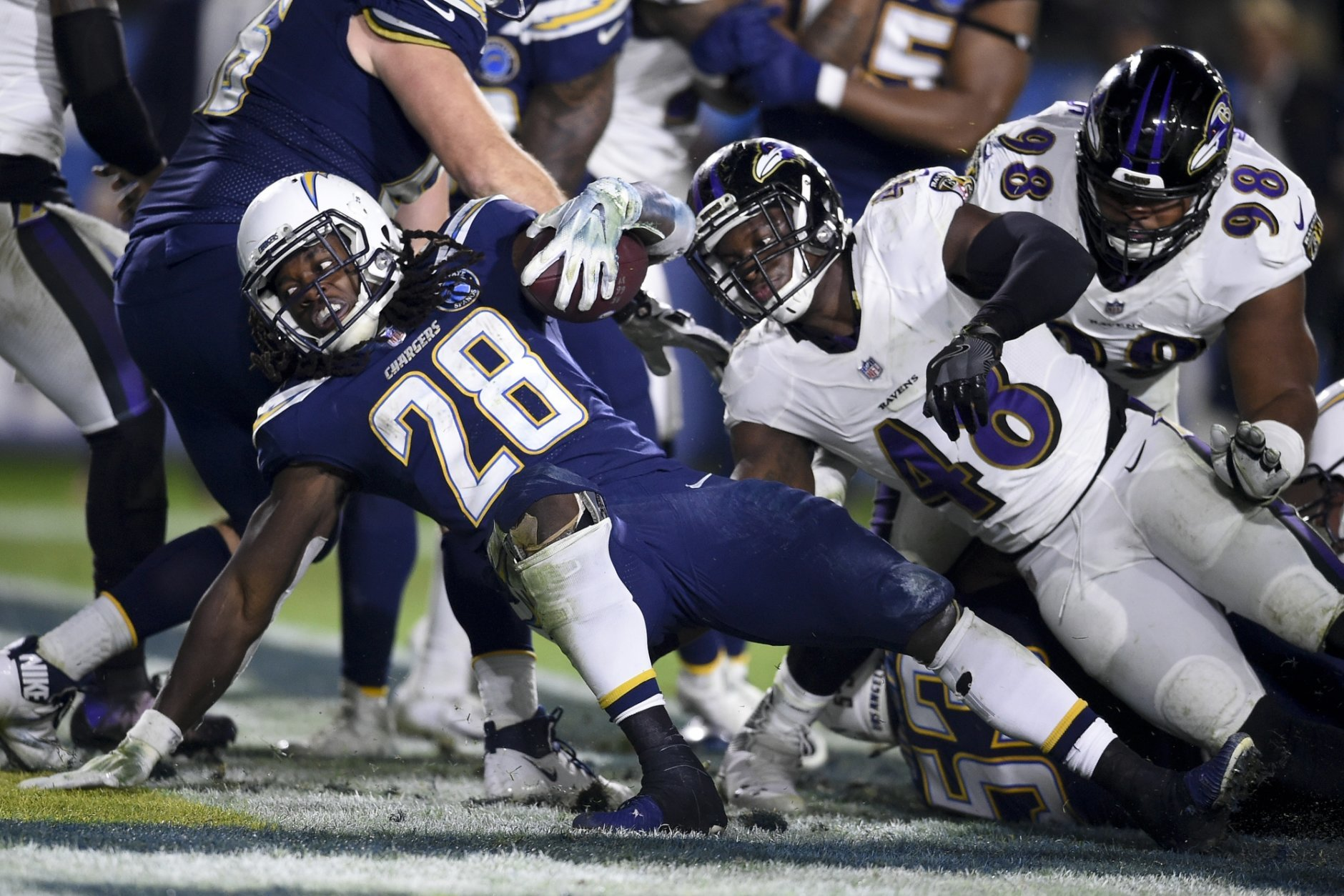 Los Angeles Chargers running back Melvin Gordon scores against the Baltimore Ravens during the second half in an NFL football game Saturday, Dec. 22, 2018, in Carson, Calif. (AP Photo/Kelvin Kuo)