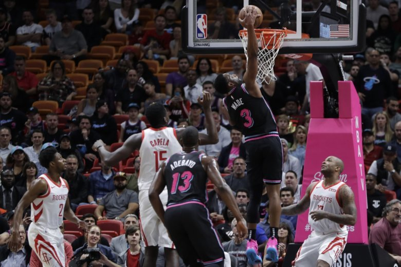 Heat snap Rockets' five-game win streak after Paul injured