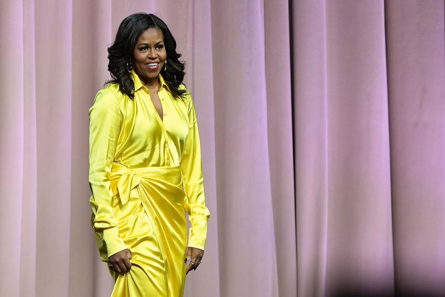 """Former first lady Michelle Obama discusses her book """"Becoming"""" at Barclays Center on December 19, 2018, in New York. Penguin Random House announced on March 26, 2019, that her memoir has sold nearly 10 million copies."""