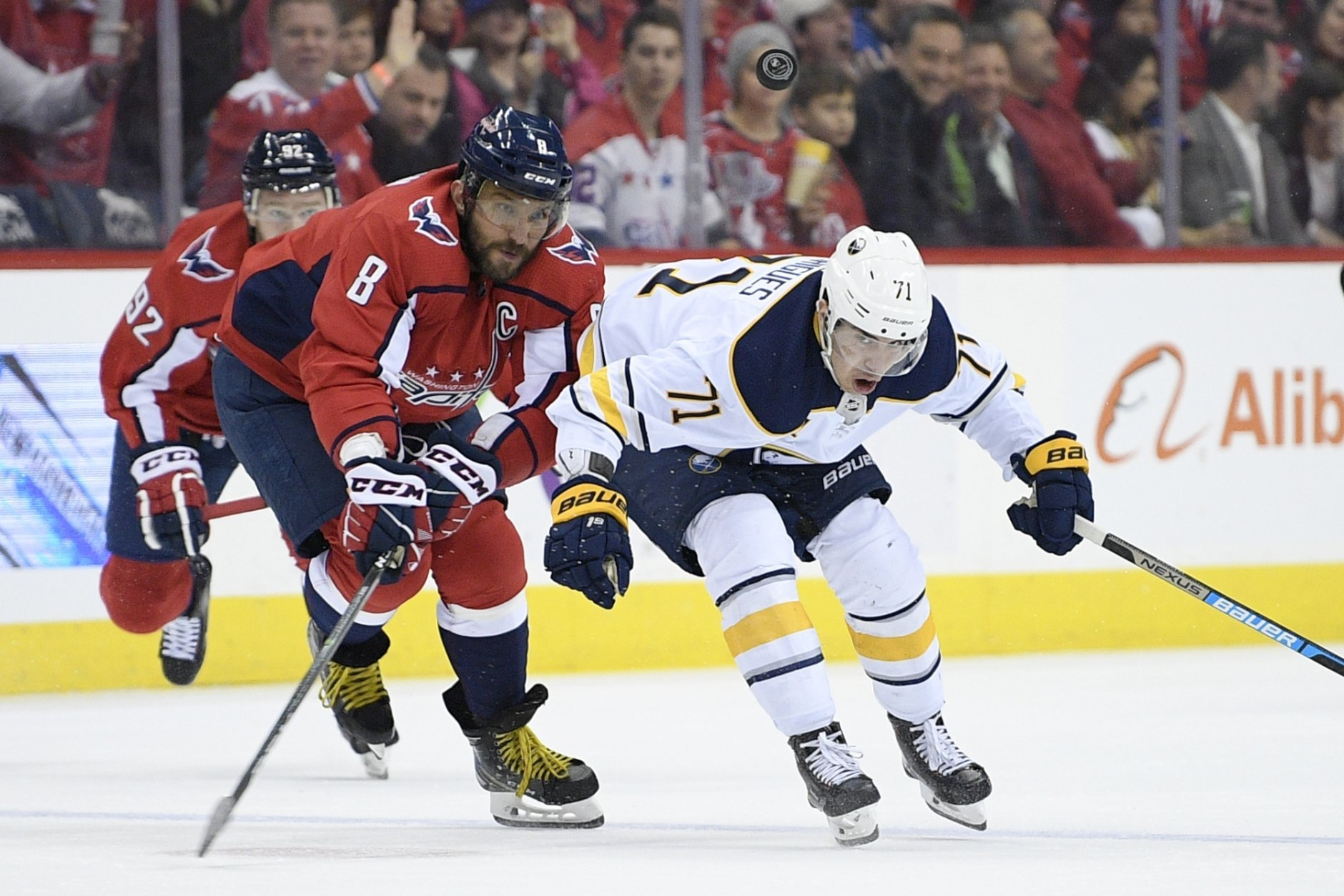 Washington Capitals left wing Alex Ovechkin (8), of Russia, battles for the puck against Buffalo Sabres left wing Evan Rodrigues (71) during the second period of an NHL hockey game, Friday, Dec. 21, 2018, in Washington. (AP Photo/Nick Wass)