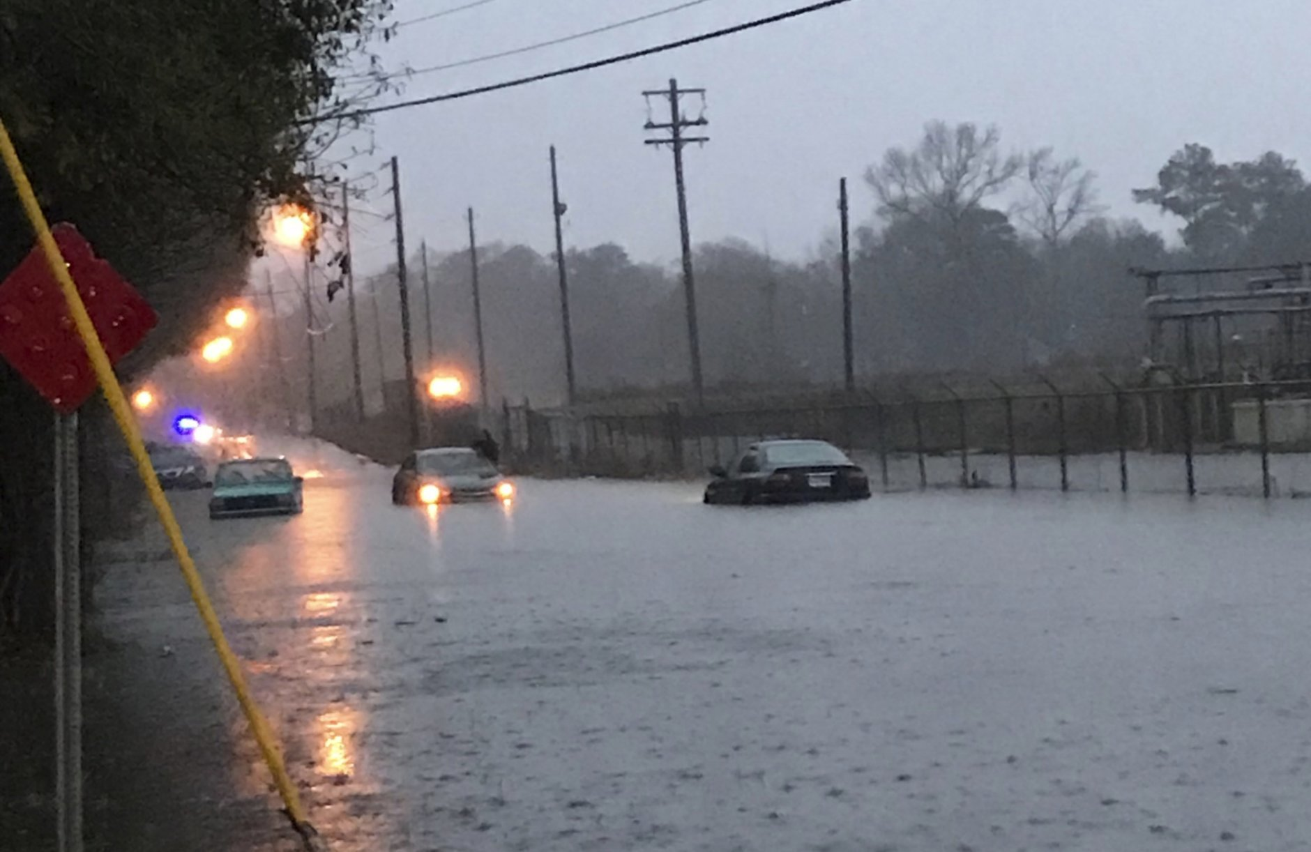 In this photo provided by the Hattiesburg Police Department, drivers attempt to drive through flash flood waters in Hattiesburg, Miss., Thursday, Dec. 27, 2018. A storm system dumped up to 12 inches of rain in Louisiana and Mississippi, Thursday afternoon through early Friday morning. (Ryan Moore/Hattiesburg Police Department via AP)