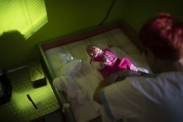 In this Nov. 16, 2018, photo, a nurse dresses a baby at the Kezmarok hospital in Kezmarok, Slovakia. An investigation by The Associated Press has found that women and their newborns in Slovakia are routinely, unjustifiably and illegally detained in hospitals across the European Union country. (AP Photo/Felipe Dana)