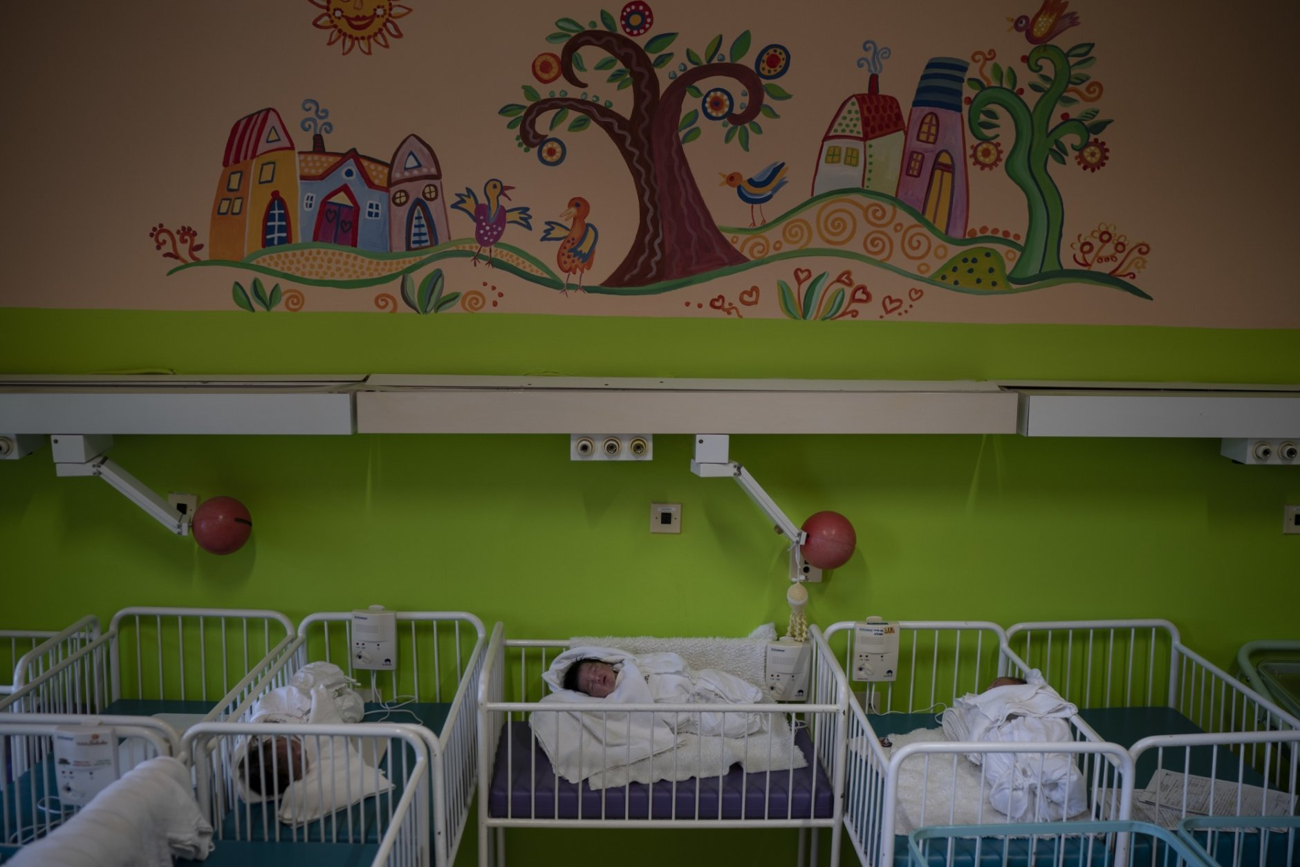 In this Nov. 16, 2018, photo, three babies whose mothers absconded the hospital, rest in their cribs at the Kezmarok hospital in Kezmarok, Slovakia. An investigation by The Associated Press has found that women and their newborns in Slovakia are routinely, unjustifiably and illegally detained in hospitals across the European Union country. (AP Photo/Felipe Dana)