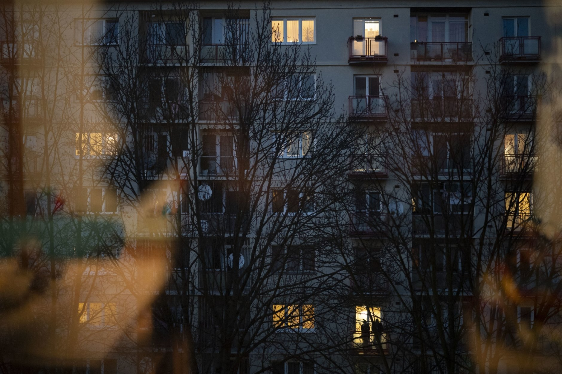 In this Nov. 11, 2018, photo, a couple stands on the balcony of their apartment in Zilina, Slovakia. An investigation by The Associated Press has found that women and their newborns in Slovakia are routinely, unjustifiably and illegally detained in hospitals across the European Union country. (AP Photo/Felipe Dana)