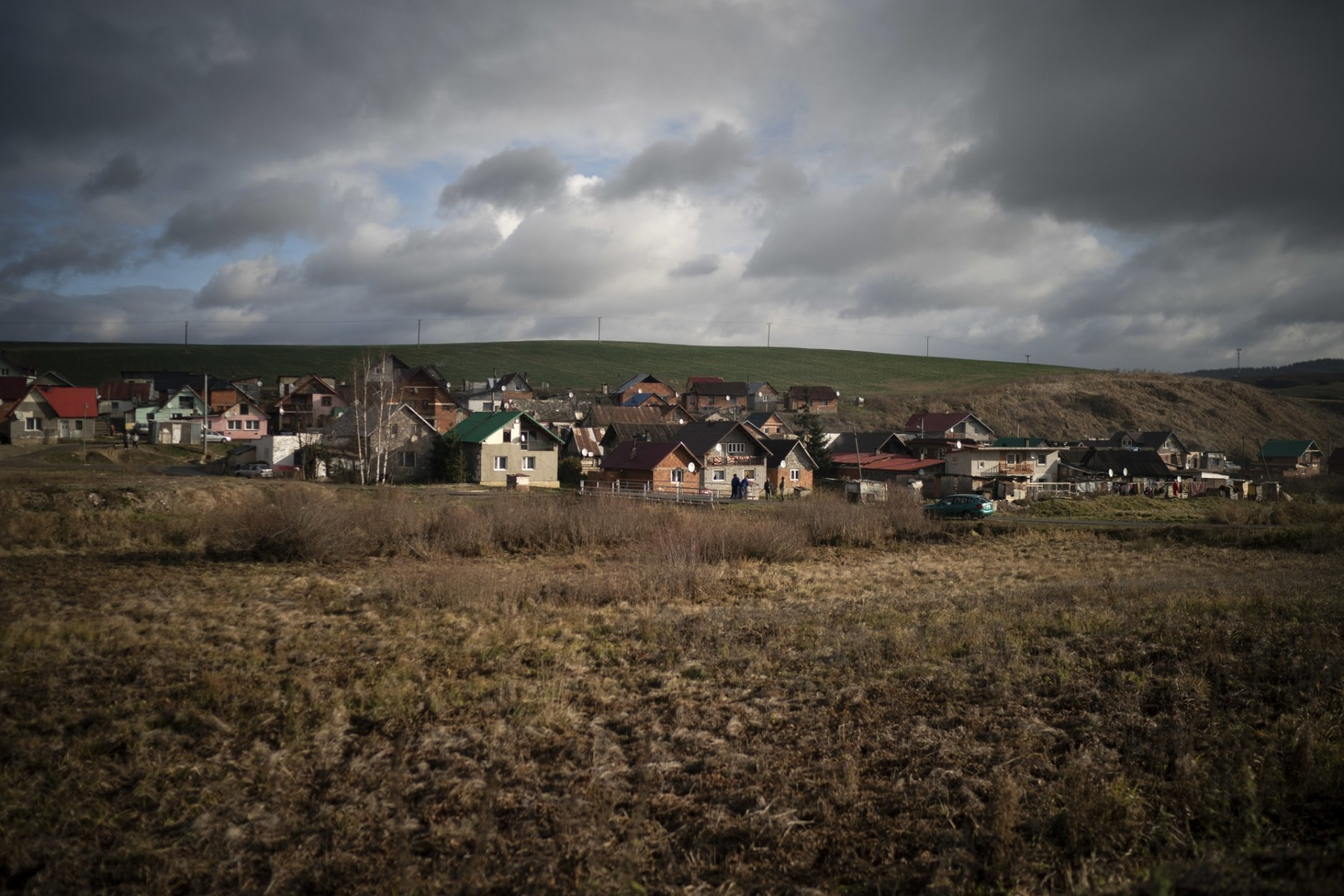 In this Nov. 14, 2018, photo, dark clouds hover over Podhorany village after a storm near Kezmarok, Slovakia. An investigation by The Associated Press has found that women and their newborns in Slovakia are routinely, unjustifiably and illegally detained in hospitals across the European Union country. Roma women, vulnerable to racist abuse and physical violence, suffer particularly.  They're also often poor, and mothers who leave hospitals before doctors grant permission forfeit their right to a significant government childbirth allowance of several hundred euros. (AP Photo/Felipe Dana)
