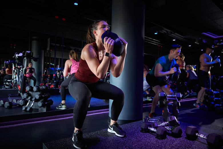 Even if you can get 25 squats in holding a few heavy books (or a small family member) you'll be doing something good for yourself ahead of a holiday feast. (Courtesy SweatBox)