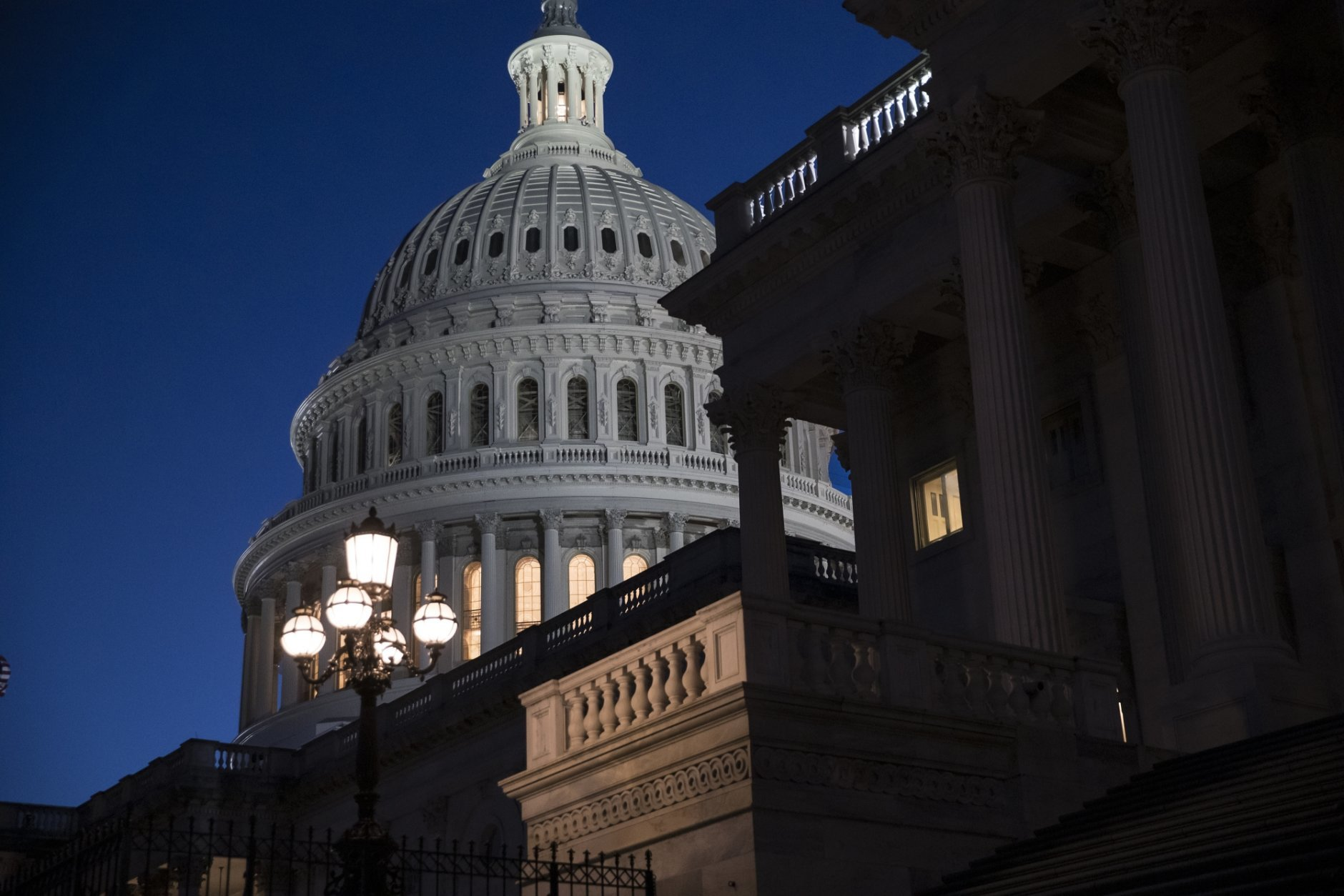 The Capitol is seen at day's end as the Senate works on a House-passed bill that would pay for President Donald Trump's border wall and avert a partial government shutdown, at the Capitol in Washington, Friday, Dec. 21, 2018. (AP Photo/J. Scott Applewhite)