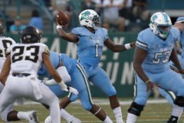 Tulane quarterback Jonathan Banks throws a pass during the first half of an NCAA college football game against Wake Forest in New Orleans on Thursday, Aug. 30, 2018. (AP Photo/Veronica Dominach)