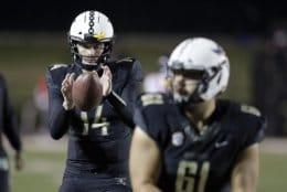 Vanderbilt quarterback Kyle Shurmur (14) warms up before an NCAA college football game against Mississippi Saturday, Nov. 17, 2018, in Nashville, Tenn. (AP Photo/Mark Humphrey)