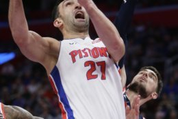 Detroit Pistons center Zaza Pachulia (27) is defended by Washington Wizards guard Ron Baker, right, while going to the basket during the first half of an NBA basketball game Wednesday, Dec. 26, 2018, in Detroit. (AP Photo/Duane Burleson)