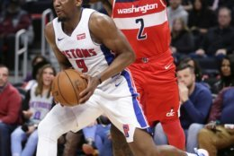 Detroit Pistons guard Langston Galloway (9) drives to the basket past Washington Wizards guard John Wall (2) during the first half of an NBA basketball game Wednesday, Dec. 26, 2018, in Detroit. (AP Photo/Duane Burleson)