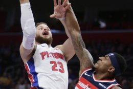 Detroit Pistons forward Blake Griffin (23) goes to the basket against Washington Wizards guard Bradley Beal (3) during the first half of an NBA basketball game Wednesday, Dec. 26, 2018, in Detroit. (AP Photo/Duane Burleson)