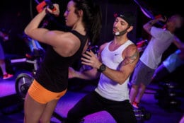 Isiah Munoz works with a client at SweatBox, an exercise studio at 1612 U St. NW. (Courtesy SweatBox)