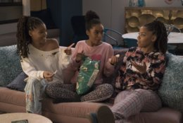 "This image released by Freeform shows Halle Bailey, from left, Yara Shahidi and Chloe Bailey in a scene from ""Grown-ish."" The program was named one of the top ten TV shows of 2018 by the Associated Press. (Tony Rivetti/Freeform via AP)"
