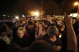 """FILE - In this Thursday, Nov. 8, 2018 file photo, mourners gather outside a coffee shop for a vigil for Sean Adler in Simi Valley, Calif. Adler was killed in Wednesday night's mass shooting at the Borderline Bar and Grill in Thousand Oaks, Calif. When a Marine combat veteran shot dead 12 people at the country music bar, it was a grim """"Not again"""" moment for many Americans _ the fifth mass shooting of the year in the U.S. that produced nationwide shock and sorrow. (AP Photo/Jae C. Hong)"""