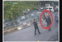 FILE - This Tuesday, Oct. 2, 2018 image from CCTV video obtained by the Turkish broadcaster TRT World and made available on Sunday, Oct. 21, 2018, alleges to show journalist Jamal Khashoggi, being allowed to enter through barriers that block the road leading to the Saudi consulate in Istanbul. For weeks, Saudi authorities issued a variety of denials. But eventually it became clear that Washington Post columnist Jamal Khashoggi, a native of Saudi Arabia fiercely critical of its royal regime, was killed on Oct. 2 inside the Saudi consulate in Istanbul. (CCTV/TRT World via AP)