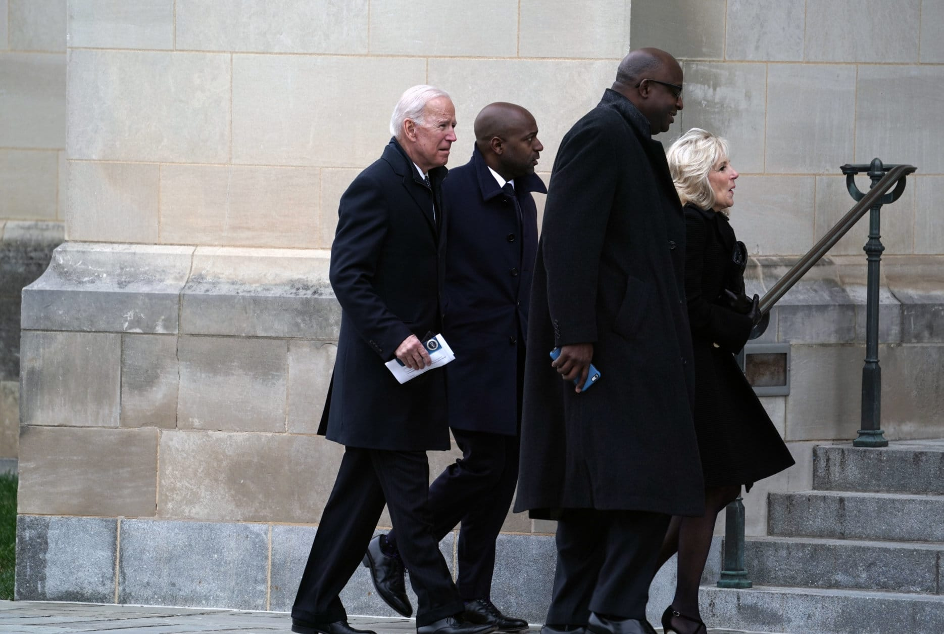 Former Vice President Joe Biden (L) along with his wife Jill Biden arrive for the funeral of late former U.S. President George H.W. Bush at the Washington National Cathedral December 5, 2018 in Washington, DC. President Bush will be buried at his final resting place at the George H.W. Bush Presidential Library at Texas A&M University in College Station, Texas. A WWII combat veteran, Bush served as a member of Congress from Texas, ambassador to the United Nations, director of the CIA, vice president and 41st president of the United States. (Photo by Alex Wong/Getty Images)