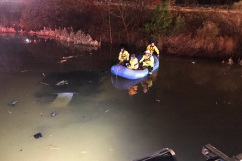Car goes off Beltway ramp into retention pond in Prince George's Co.