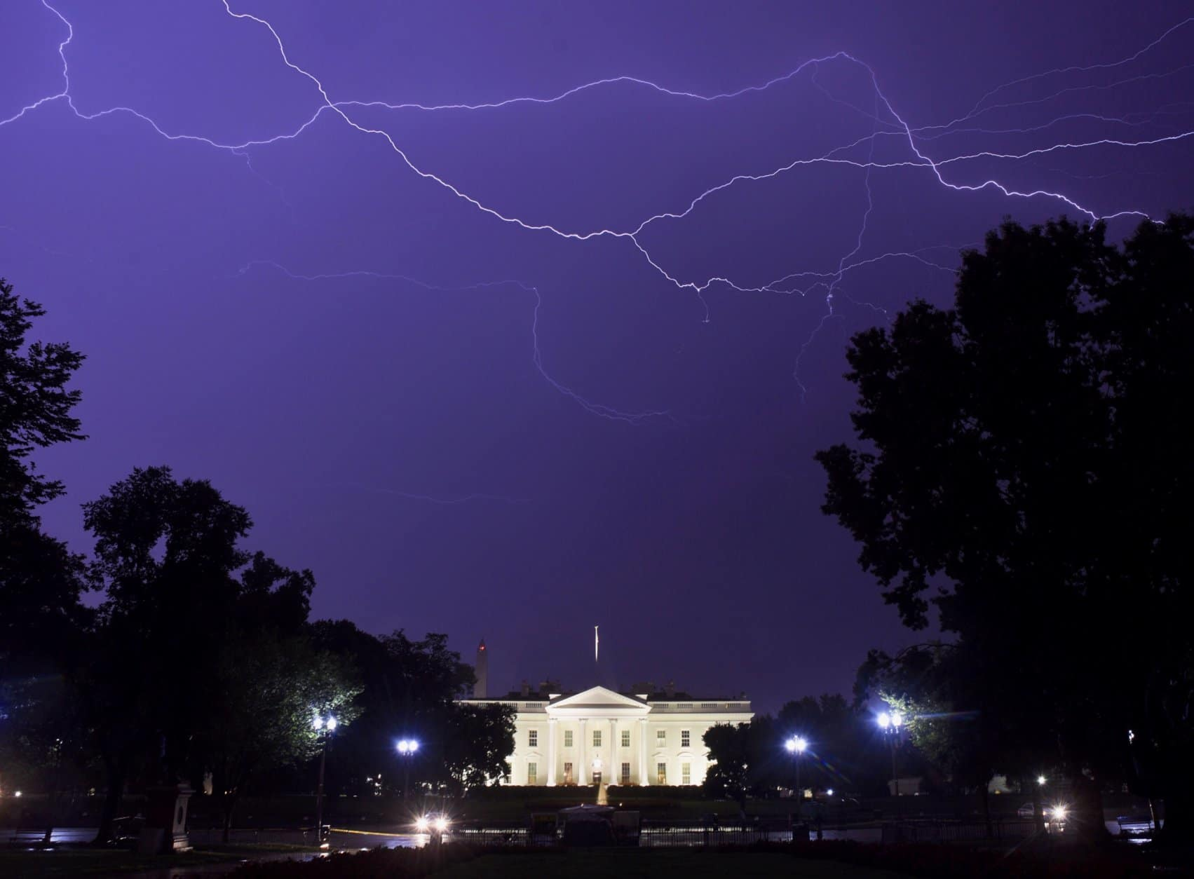 Spider lightning streaks across the sky above the White House on Sept. 7, 2018. The drenching storms unloaded 2.89 inches of rain on the District in just a few hours, making that Friday one of the wettest days of the what would eventually become wettest year ever. (WTOP/Dave Dildine)