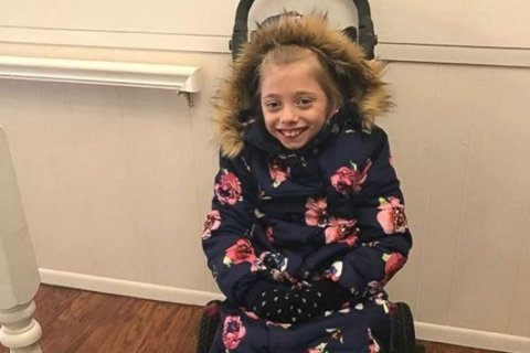 Girl in wheelchair can stay warm outside thanks to mom's invention
