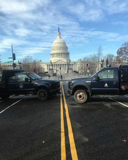 Official vehicles barricade part of the way along East Capitol Street in D.C. (WTOP/Mitchell Miller)
