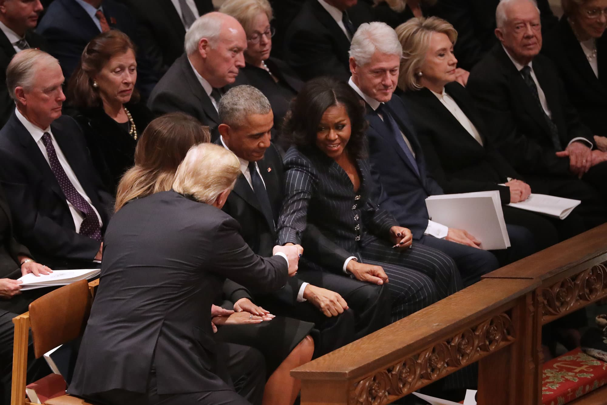 President Donald Trump and first lady Melania Trump greet former President Barack Obama and Michelle Obama as they join other former presidents and vice presidents and their spouses for the state funeral for former President George H.W. Bush at the National Cathedral December 05, 2018 in Washington, DC. A WWII combat veteran, Bush served as a member of Congress from Texas, ambassador to the United Nations, director of the CIA, vice president and 41st president of the United States.  (Photo by Chip Somodevilla/Getty Images)