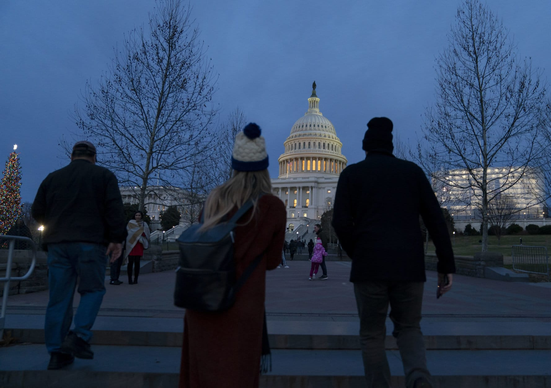 The Capitol is seen as New Year's Day comes to a close with the partial government shutdown in its second week, in Washington, Tuesday, Jan. 1, 2019. The new House majority led by Democrat Nancy Pelosi gavels into session this week with legislation ready to end the government shutdown. (AP Photo/J. Scott Applewhite)