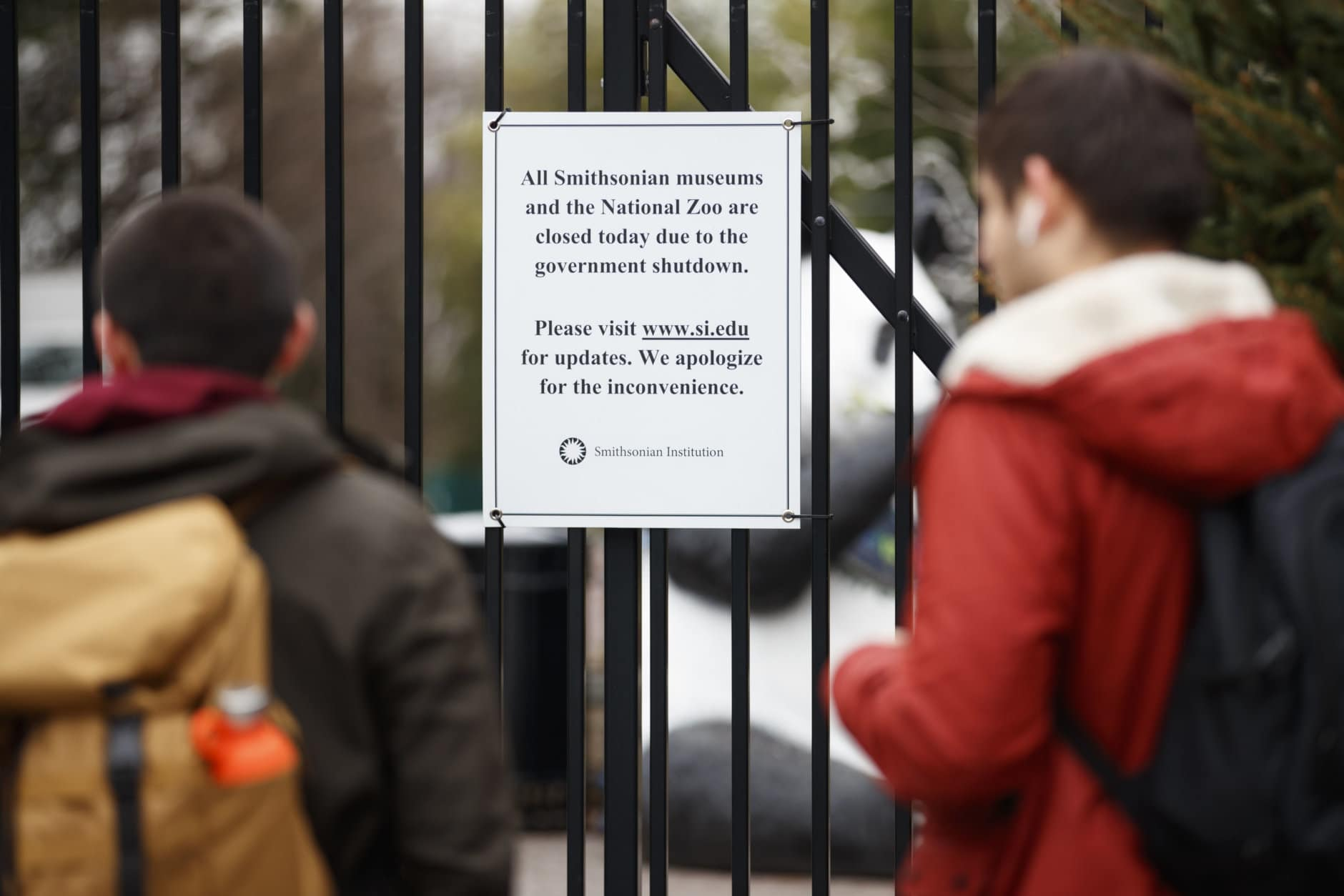 A closed sign is posted on the gate of Smithsonian's National Zoo, Wednesday, Jan. 2, 2019, in Washington. Smithsonian's National Zoo is closed due to the partial government shutdown. President Donald Trump is convening a border security briefing Wednesday for Democratic and Republican congressional leaders as a partial government shutdown over his demand for border wall funding entered its 12th day. (AP Photo/Carolyn Kaster)