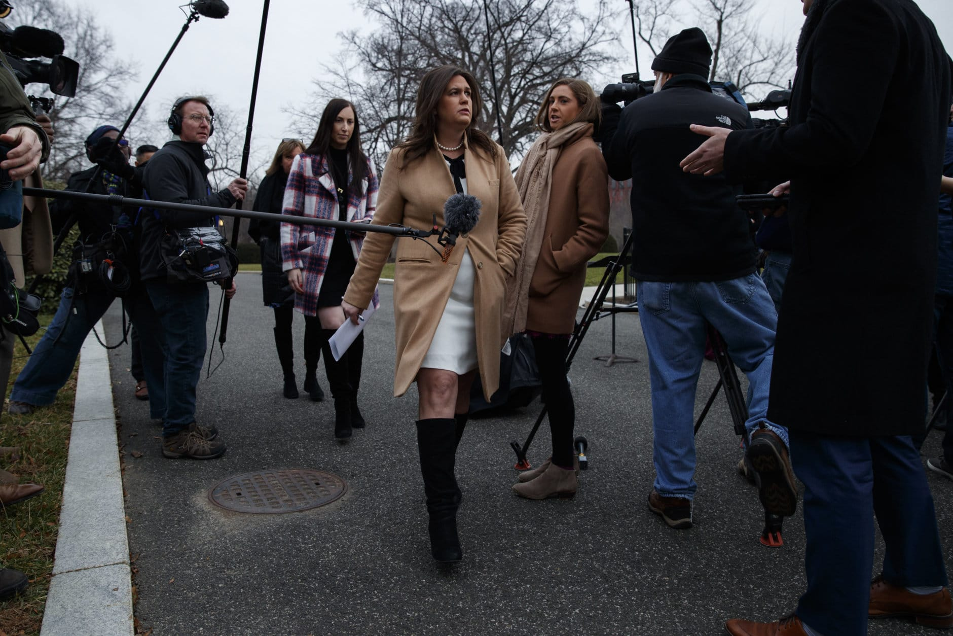 White House press secretary Sarah Huckabee Sanders walks off after speaking with reporters about the government shutdown outside the White House, Friday, Jan. 4, 2019, in Washington. (AP Photo/Evan Vucci)