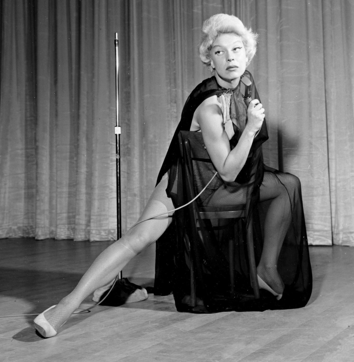 Actress and comedienne Carol Channing performs in her first nightclub opening appearance in Las Vegas, Nev., on July 9, 1957.  Channing wears an $11.85 costume as she impersonates Marlene Dietrich, who recently appeared on a neighboring stage in a $20,000 gown.  (AP Photo)