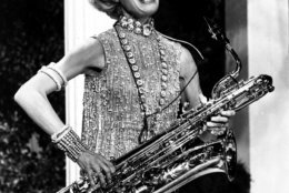 """Carol Channing sings and plays the bass saxophone in a scene from the movie """"Thoroughly Modern Millie"""" during rehearsal in Hollywood, Ca., on Nov. 17, 1966. (AP Photo)"""