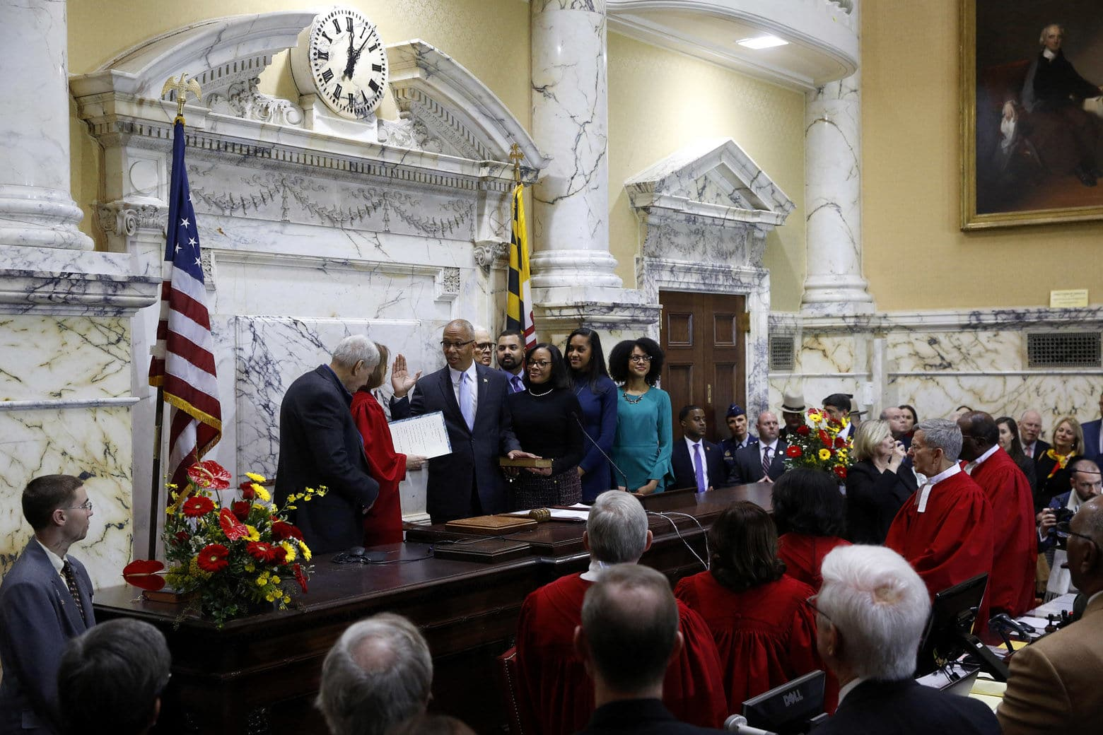 Maryland Lt. Gov. Boyd Rutherford, accompanied by his wife Monica and family, takes the oath of office from Mary Ellen Barbera, Chief Judge of the Maryland Court of Appeals, inside the State Senate chamber, Wednesday, Jan. 16, 2019, in Annapolis, Md. (AP Photo/Patrick Semansky, Pool)