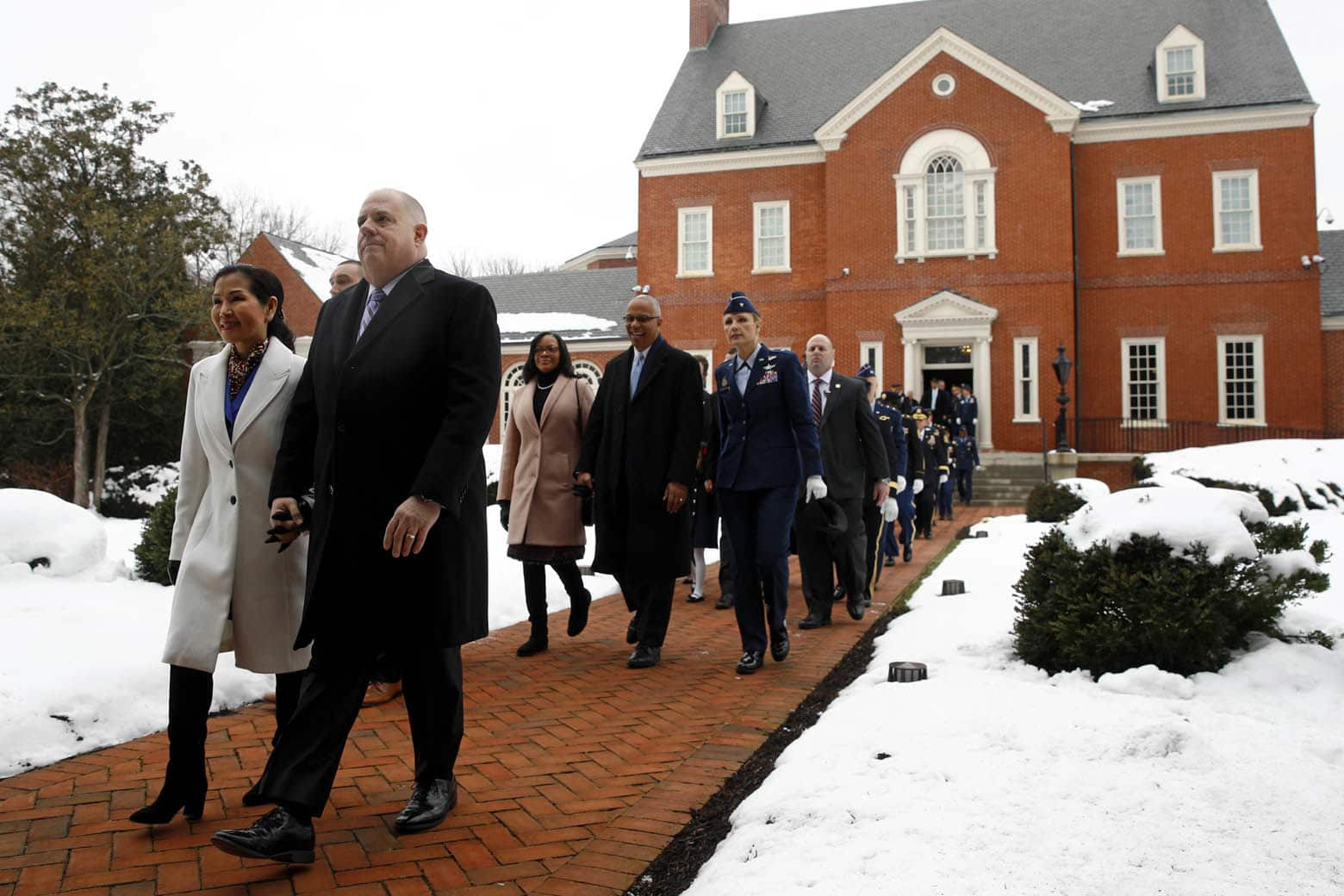 Maryland Gov. Larry Hogan, second from left, departs Government House, the Governor's mansion, with first lady Yumi Hogan before his inauguration ceremony, Wednesday, Jan. 16, 2019, in Annapolis, Md. Hogan is the first Republican governor to be re-elected in the state since the 1950s. (AP Photo/Patrick Semansky)