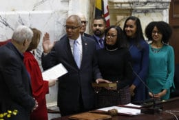 Maryland Lt. Gov. Boyd Rutherford, third from left, accompanied by his wife Monica and family, takes the oath of office from Mary Ellen Barbera, Chief Judge of the Maryland Court of Appeals inside the State Senate chamber, Wednesday, Jan. 16, 2019, in Annapolis, Md. (AP Photo/Patrick Semansky, Pool)