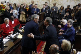Former Florida Gov. Jeb Bush, left, greets former Maryland Gov. Robert Ehrlich, right, as they wait to see Maryland Gov. Larry Hogan take the oath of office inside the State Senate chamber, Wednesday, Jan. 16, 2019, in Annapolis, Md. (AP Photo/Patrick Semansky, Pool)