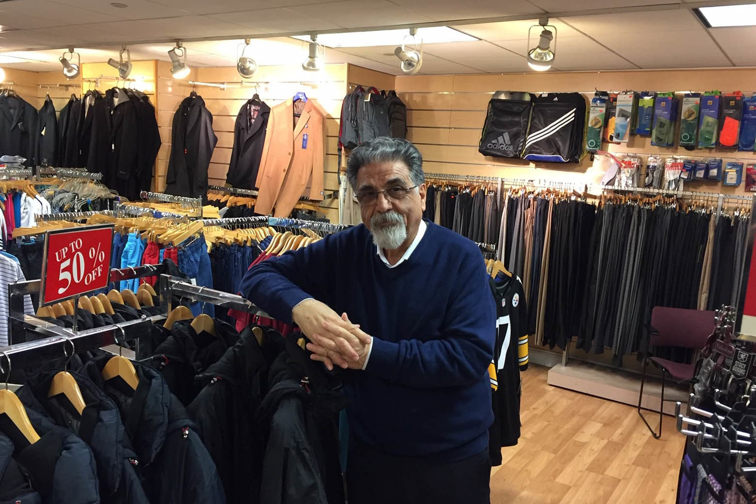 Harry Nash has sold menswear for 31 years at L'Enfant Plaza. He said he's expecting sales to decline by more than 50 percent this month. (WTOP/John Domen)