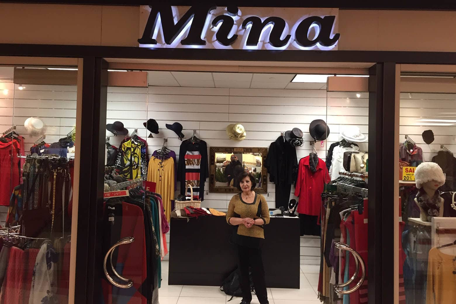 """I told my employee not to show up until I call them,"" said Mina Tamami, who operates Mina's Boutique with her husband. ""The past month, nothing. Nobody's here. It's like a ghost town."" (WTOP/John Domen)"